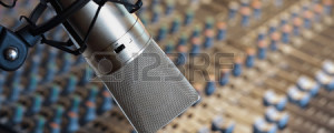 25907176-studio-microphone-in-front-of-mixing-console-in-recording-studio